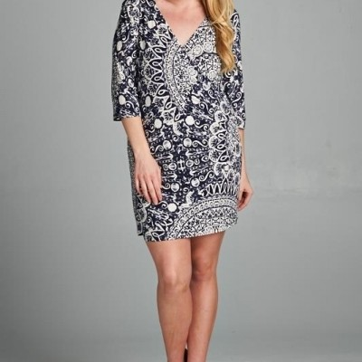 A beautiful navy and white print wrap dress by Tua.   Has a flattering hand to it, feels pretty and feminine when you put it on.